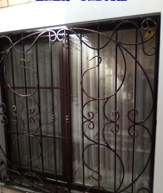 Кованые решетки на окна ручной работы от Наковали