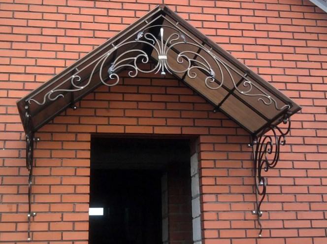 Кованый козырек с двухскатной крышей фото цены от Наковали